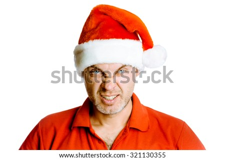 Unshaven blue eyes angry man in a red shirt and Santa hats. Studio. isolated - stock photo