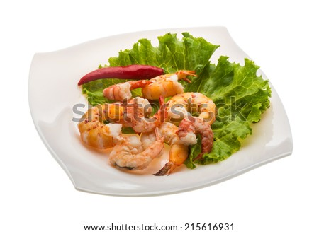 Unshelled king prawn heap with salad leaves
