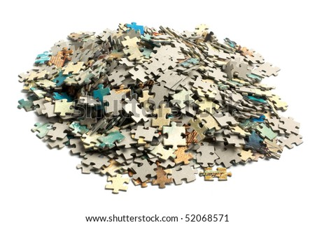 unsolved bunch of jigsaw puzzles pieces isolated on white - stock photo