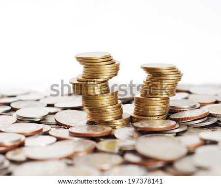 Unstable stack coins - stock photo