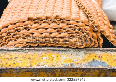 Unused carpet underlay in a waste skip - stock photo