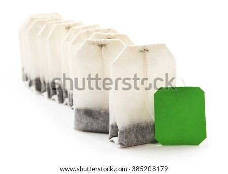 Unused teabags in a row isolated on white background - stock photo