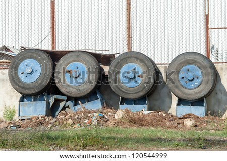unused tower crane wheels - stock photo