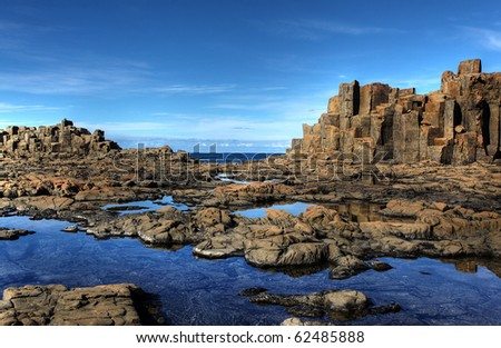 unusual coastal rock formations at kiama - stock photo