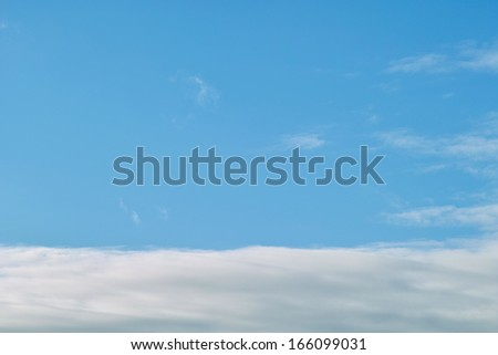 Unusual colored background of the daytime sky with clouds