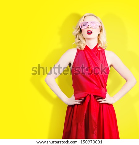 Unusual colorful portrait of a fashion model girl in summer glasses. Bright yellow color background  - stock photo