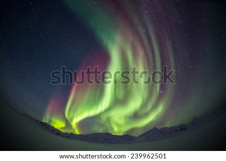 Unusual Northern Lights over the Arctic glacier valley - Svalbard - stock photo