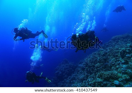 unusual photo diver underwater background