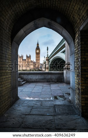 Unusual point of view at framed Westminster Palace in London with Big Ben at tower and bridge on Thames river - stock photo