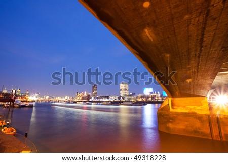 Unusual view of London's night skyline from Waterloo Bridge - stock photo