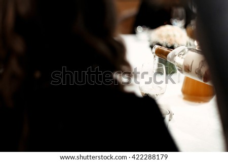 unusual view of waiter pouring glasses with wine or champagne at luxury celebration, catering in restaurant - stock photo