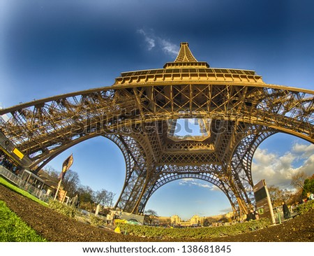 Unusual wide angle view inside the center of the Eiffel tower in Paris - France - stock photo