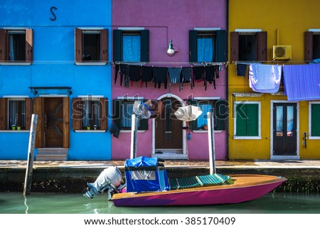 Unusually colorful houses in an artistic medieval village of Burano, Italy.
