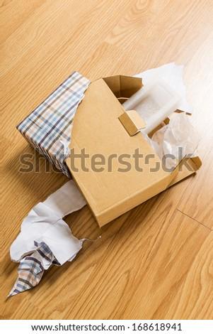 Unwrap of gift  - stock photo