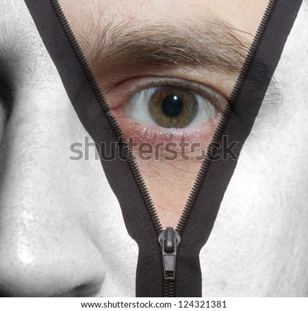Unzipping black and white face to a colored face - stock photo