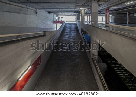 Up and down way in parking garage interior ,industrial building,Empty underground  - stock photo