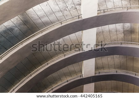 Up and down way to parking lot in exterior building, Circle cement way to parking - stock photo