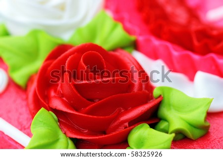 Up-close rose shaped cake icing for birthday, anniversary or Valentine's Day. - stock photo