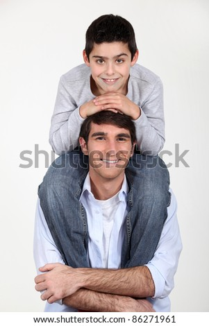 up on daddy's shoulder - stock photo