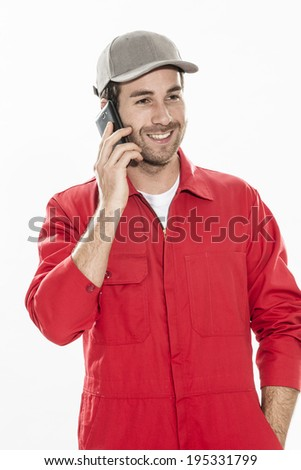 up portrait of a technician with expressive face using a smartphone - stock photo