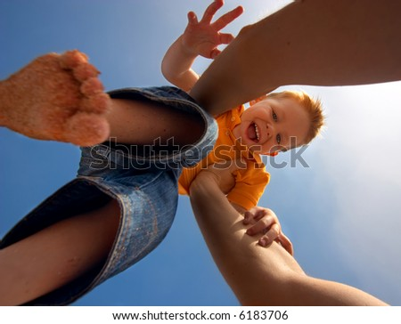 Up to the sky. Cute 3 years old boy having fun when thrown up to the sky - stock photo