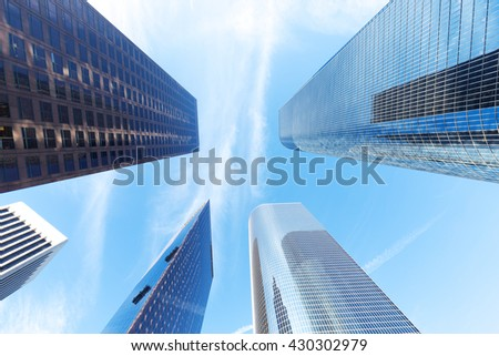 up view of modern office building in cloud sky
