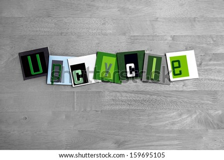 Upcycle - business eco sign - concept for green recycling of resources, carbon footprint, renewable energy and looking after the environment. - stock photo