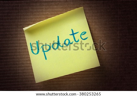 update text on yellow sticky note - stock photo