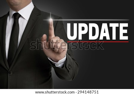 Update touchscreen is operated by businessman. - stock photo
