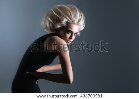 Updo Vogue Style. Woman with Futuristic Hairdo. Stop hand gesture.