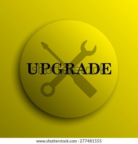Upgrade icon. Yellow internet button.  - stock photo