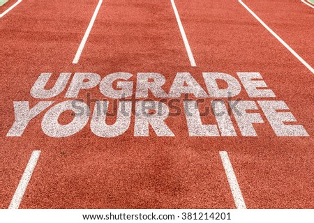 Upgrade Your Life written on running track - stock photo