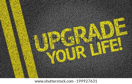 Upgrade Your Life! written on the road - stock photo