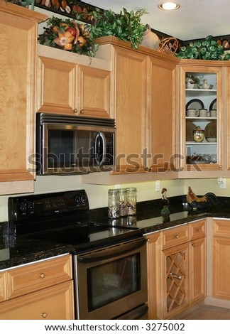 Upgraded kitchen cabinets and stainless steel ovens - stock photo