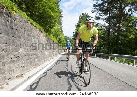 uphill race man and woman - stock photo