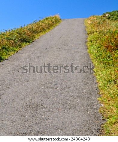 uphill road seeming to end abruptly jumping into the sky