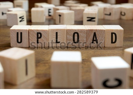 upload word written on wood block - stock photo