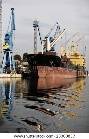 Uploading industrial tanker at an old Bulgarian harbor