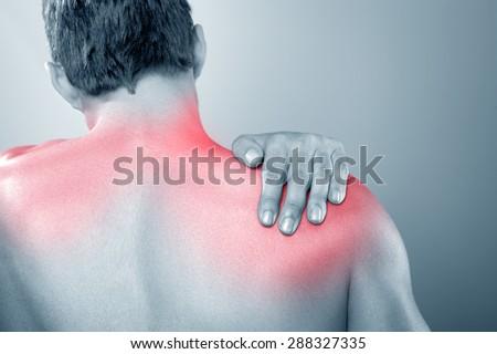 Upper back pain - stock photo