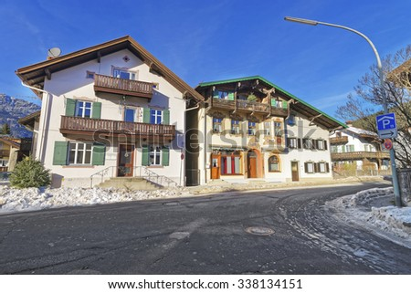 Upper Bavarian-styled houses in Garmisch-Partenkirchen with window shutters painted in bright colors and lovingly painted facades. Bavaria, southern Germany - stock photo