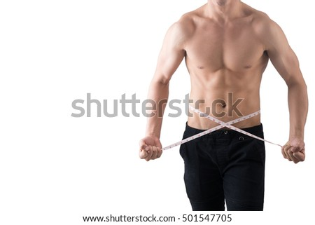Upper body of handsome guy holding measuring tape and winding at his waist.