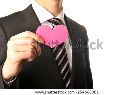 Upper body of men of businessmen have a pink heart