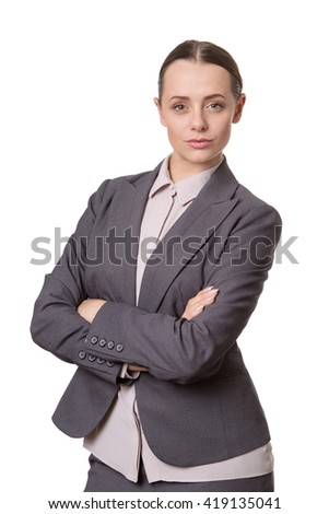 Upper body studio shot of a pretty business model standing up with her arms folded.  Isolated on a white background.