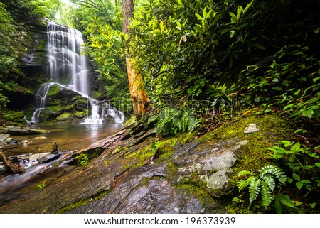 Upper Catabwa Falls is a 50-feet waterfall that leads to another amazing lower waterfall. Located in Old Fort, North Carolina.  - stock photo
