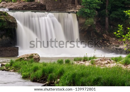 Upper Cataract Falls (Indiana) photographed with a long exposure yielding silky smooth motion-blurred water. - stock photo