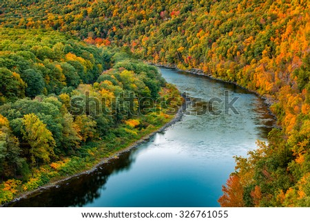 Upper Delaware river bends through a colorful autumn forest, in Hawk's Nest, near Port Jervis, New York - stock photo