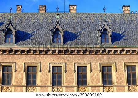Upper facade and traditional roof top of a building of the Prague castle, Czech Republic - stock photo