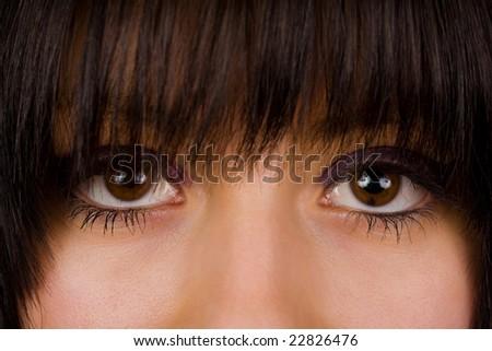 Upper half of a beautiful brunette's face - stock photo