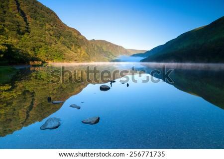 Upper Lake in Glendalough Scenic Park, County Wicklow, Republic of Ireland - stock photo