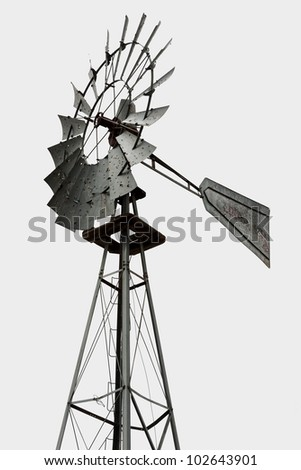 Upper part of a windmill for water pumping over white - stock photo